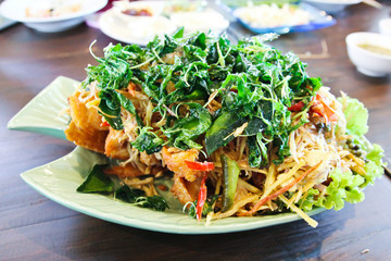 Deep fried fish with herb and spicy sauce, thai food.