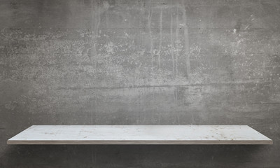 Gray wall texture in background. White table with free space.