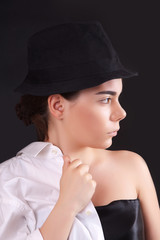 Portrait of a young woman in a hat