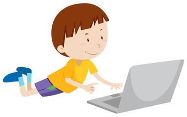 Little boy working on computer