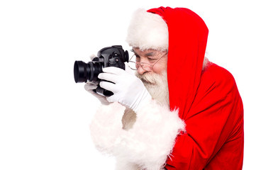 Santa claus taking photo by camera