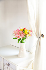Alstroemeria flowers in vase on table