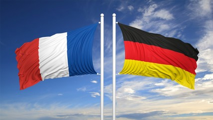 French and German flags against of sky