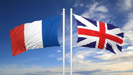 French and British flags against of sky