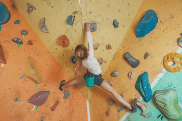 Girl climbing in gym