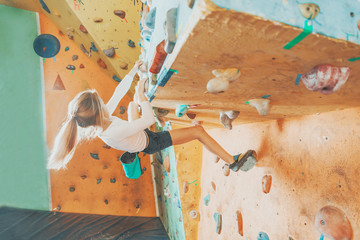 Girl practicing in climbing gym