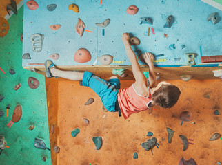 Boy practicing in climbing gym