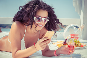 Closeup young beautiful happy, excited smiling woman texting