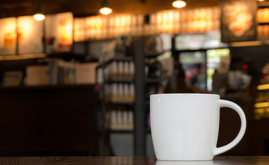 White Coffee Mug On Wooden Table In Cafe With Copyspace