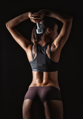 Sexy athletic woman working out with dumbbells