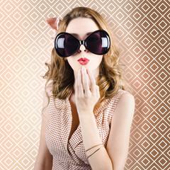 Beautiful surprised girl wearing big sunglasses