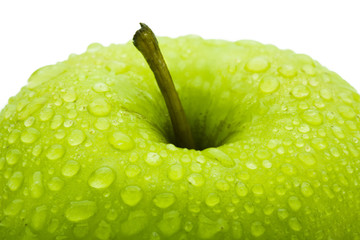 Closeup of the green apple covered dew