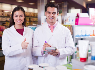team of pharmaceutist and technician working in chemist shop