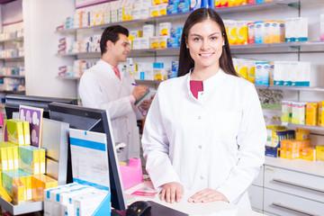 Pharmacist standing at pay desk