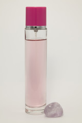 Pink perfume bottle on a white background.