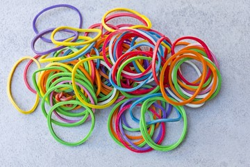 Group of multicolor rubber money bands.