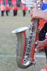 Fragment of a saxophone in sport day with the orchestra closeup