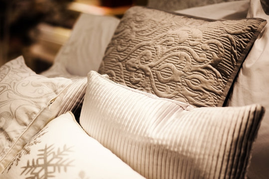 many pillows on the bed