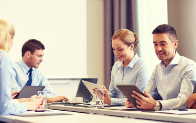 smiling business people with tablet pc in office