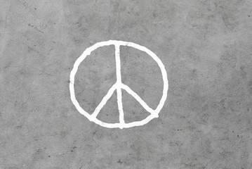 peace sign drawing on gray concrete wall