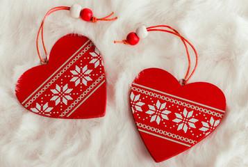 Christmas hearts on a white fur