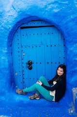 Tourist enjoying the blue city of Morocco