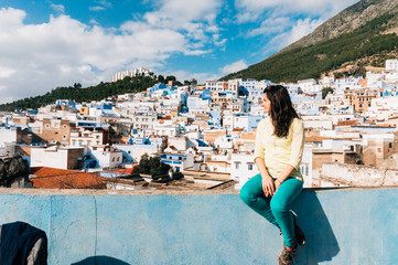 Female tourist looking at Chefchaouen - city of Morocco