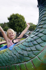 Young girl on green fair ride