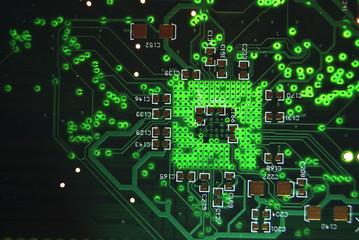 Printed circuit board closeup green electronic background