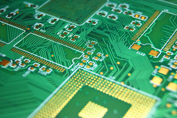 Printed circuit board closeup green electronic background