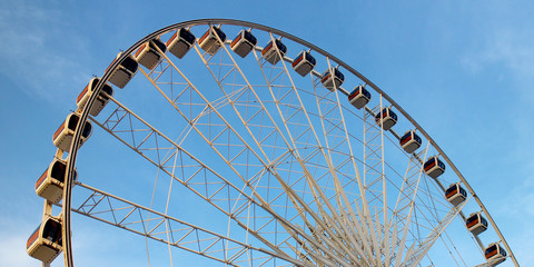 Ferris Wheel in Blue Sky