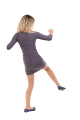 skinny woman funny fights waving his arms and legs.