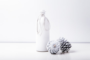 White bottle with cones on the white background