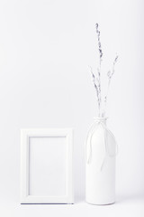 White frame with a bottle on a white background