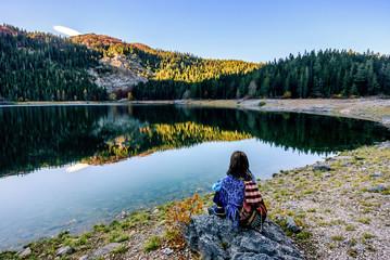 Young woman admires beautiful panorama of Black Lake
