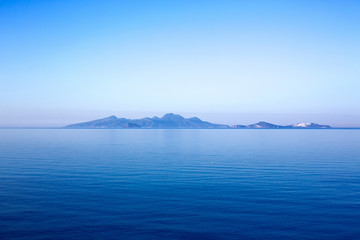 Nisyros volcano on the horizon in the morning