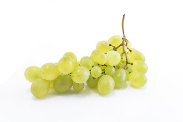 Green grapes isolated on white