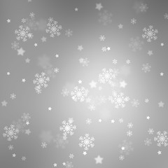 Silver colored blurry bokeh with blurred star shapes and snowflakes. Magic Christmas and New Year snowy Holiday greeting card copy space background.