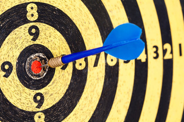 Lucky concept: photography success hitting target aim goal Blue Dart in bull's eye
