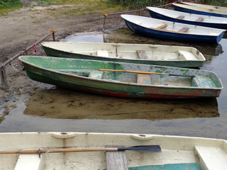 The boats at the shore of the lake