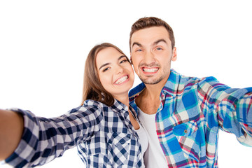 Cheerful funny couple in love making selfie photo