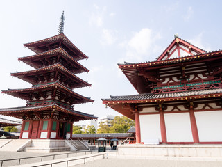 Red five story pagoda and hall of Shitennoji buddhist temple in Osaka, Japan