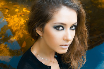 Beauty model girl with makeup smoky eyes