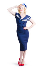 Young retro pinup girl wearing sailor uniform