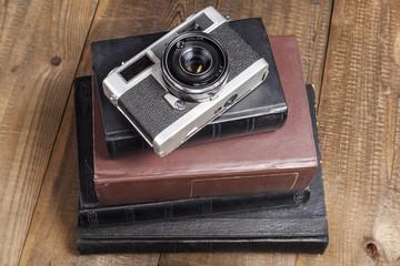 Silver Camera on Books