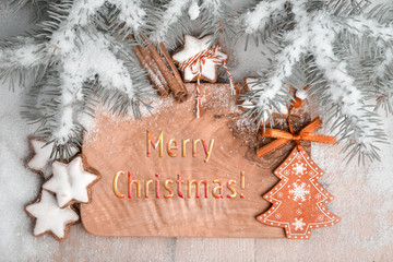Christmas greeting card with seasonal decorations and cookies