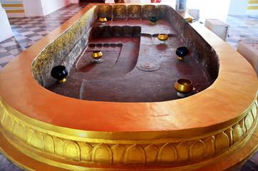 Buddha's footprint 4 footprints at Prasat Nakhon Luang