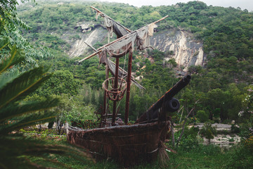 Old pirate sailboat in the jungle.