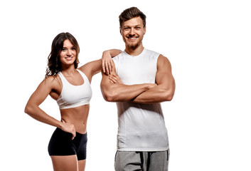 Young and beautiful athletic woman and man isolated on white