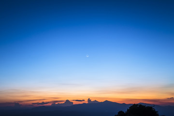 twilight sky with the crescent moon in winter at the north of Thailand